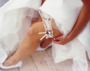 bride displaying garter
