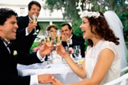 couple toasting at outdoor reception