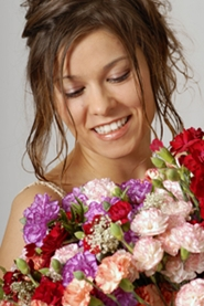 young bride with floral arrangement