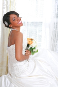 lovely young bride posing in her wedding gown