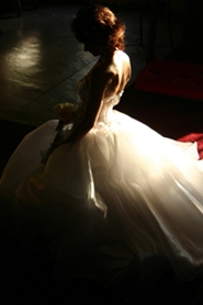 dramatic portrait of bride in her wedding gown