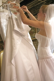 young bride hanging up wedding gown