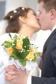 young married couple first kiss as man and wife