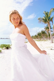 young bride on her honeymoon at the beach